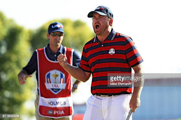 B Holmes of the United States reacts to a birdie putt on the ninth green during afternoon fourball matches of the 2016 Ryder Cup at Hazeltine...