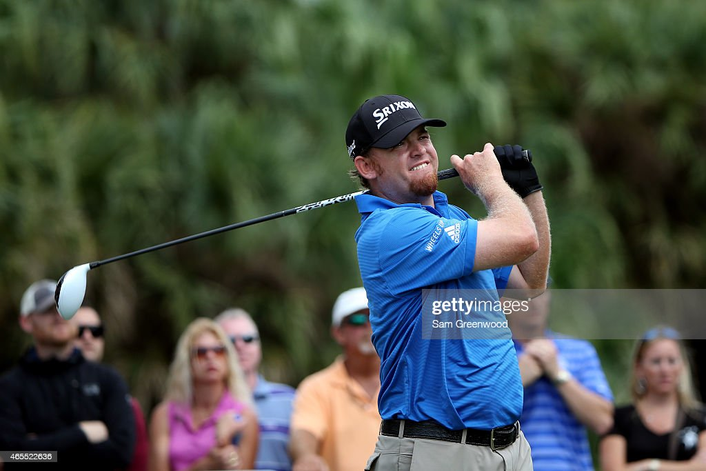 J B Holmes of the United States watches his tee shot on the seventh hole during the third round of the World Golf ChampionshipsCadillac Championship...