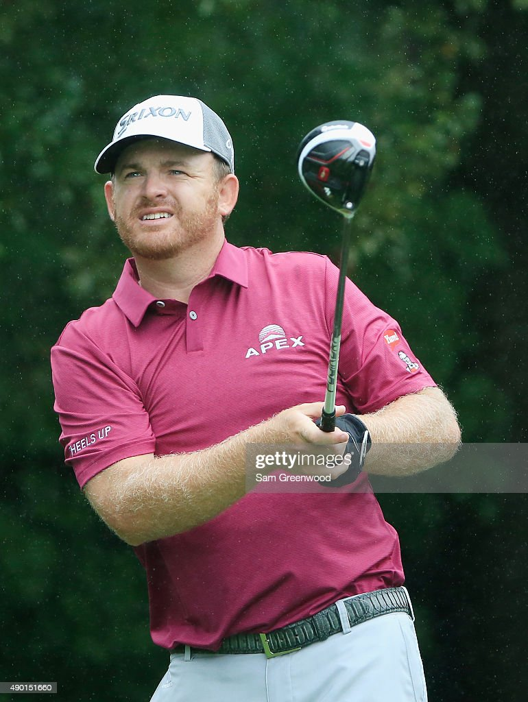 B Holmes of the United States watches his tee shot on the third hole during the third round of the TOUR Championship By CocaCola at East Lake Golf...