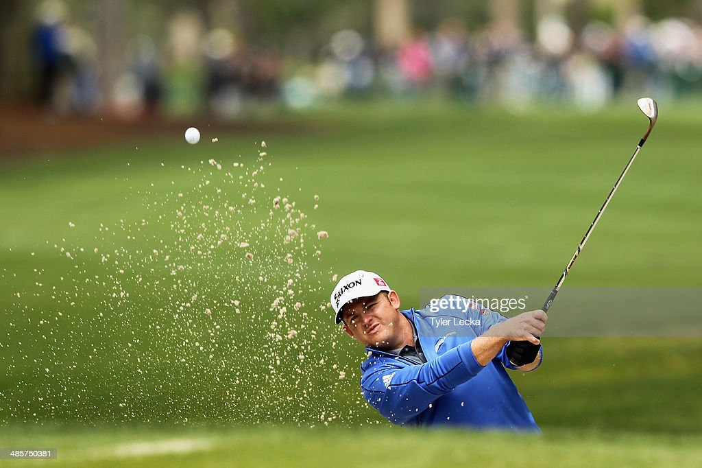 B Holmes plays a shot out of the bunker on the 1st hole during the final round of the RBC Heritage at Harbour Town Golf Links on April 20 2014 in...