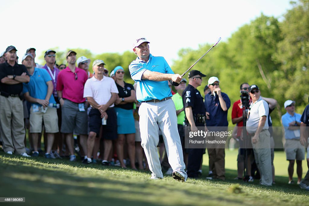 Holmes plays into the 16th green during the final round of the Wells Fargo Championship at the Quail Hollow Club on May 4 2014 in Charlotte North...