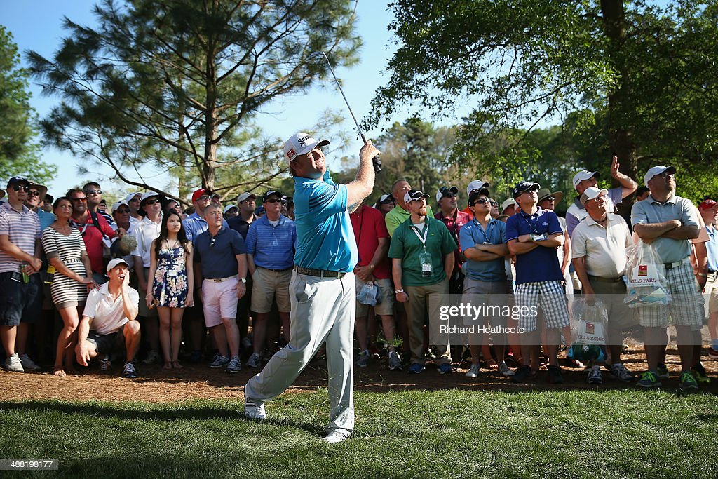 Holmes plays into the 18th green during the final round of the Wells Fargo Championship at the Quail Hollow Club on May 4 2014 in Charlotte North...