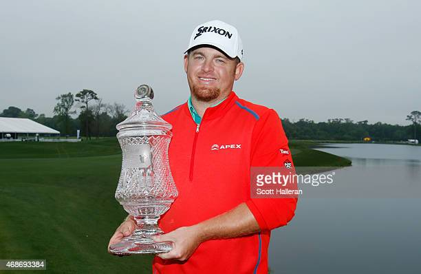 J B Holmes poses with the trophy after winning the Shell Houston Open at the Golf Club of Houston on April 5 2015 in Humble Texas
