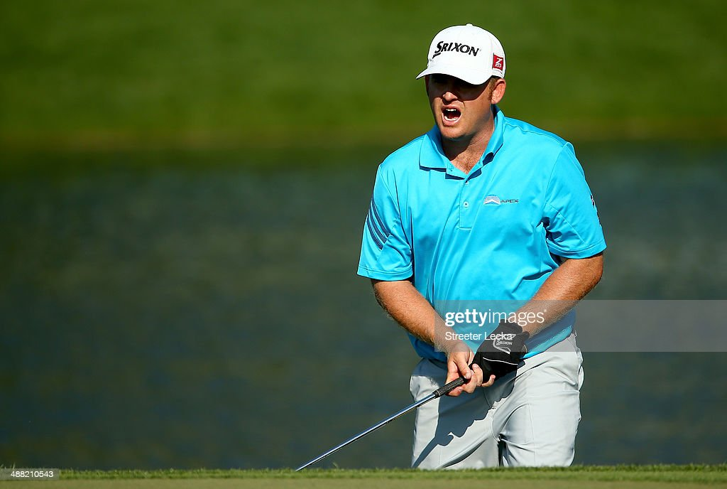 B Holmes reacts to a shot on the 16th hole during the final round of the Wells Fargo Championship on May 4 2014 in Charlotte North Carolina