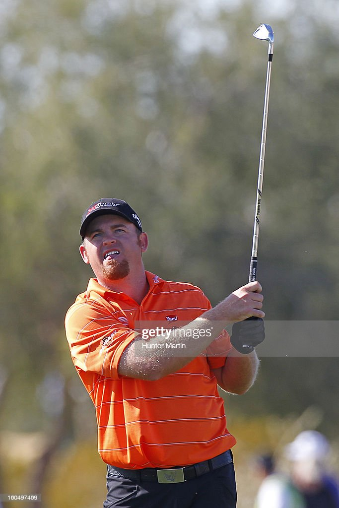 J.B. Holmes watches his second shot on the ninth hole during the second round of the Waste Management Phoenix Open at TPC Scottsdale on February 1, 2013 in Scottsdale, Arizona.