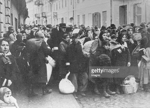 Holocaust Jews waiting on a Warsaw street for the deportation to a concentration camp Poland Photography About 1944 [Holocaust Warten von Juden auf...