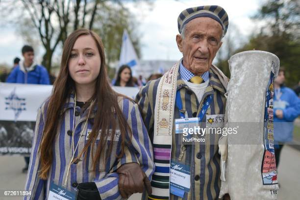 Holocaust survivor Edward Mosberg from New Jersey USA and his granddaughter Jordana Karger walk during the annual March of the Living Jewish people...