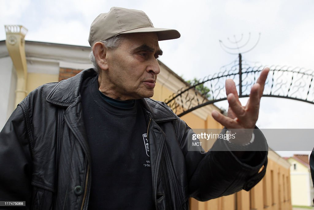 Holocaust survivor Gregory Hosid tells a story at the main gate to the Jewish Ghetto in Grodno, Belarus, May 29, 2011. Hosid jumped from the train that was taking him to Treblinka. He ran into another refugee in the snow, a man whose wounds he cleaned, a shoemaker who fixed Hosid's shoes and in turn they saved each other's lives. They joined up with the partisans in the woods to fight the Germans.