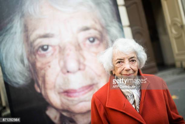 Holocaust survivor Margot Friedlander stands in front of her portrait by photographer and filmmaker Luigi Toscano during a preview of the exhibition...