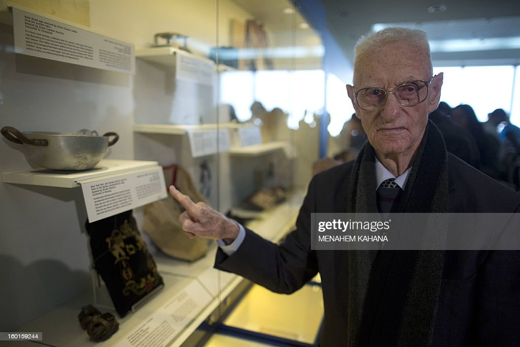 Holocaust survivor Shlomo Resnick, 85, points to the bowl that he and his father Meir used to eat from at the Dachau concentration camp during the Second World War, displayed at the Yad Vashem Holocaust museum in Jerusalem on January 27, 2013. A new display called 'Gathering the Fragments', which documents the collection, research and registration of Holocaust items, opened at the musuem on the International Holocaust Remembrance Day.