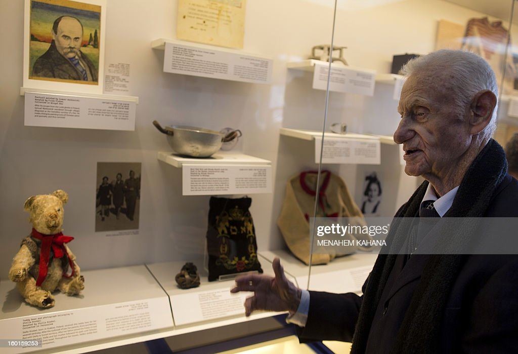 Holocaust survivor Shlomo Resnick, 85, stands in front of the bowl (C) that he and his father Meir used to eat from at the Dachau concentration camp during the Second World War, displayed at the Yad Vashem Holocaust museum in Jerusalem on January 27, 2013. A new display called 'Gathering the Fragments', which documents the collection, research and registration of Holocaust items, opened at the musuem on the International Holocaust Remembrance Day.