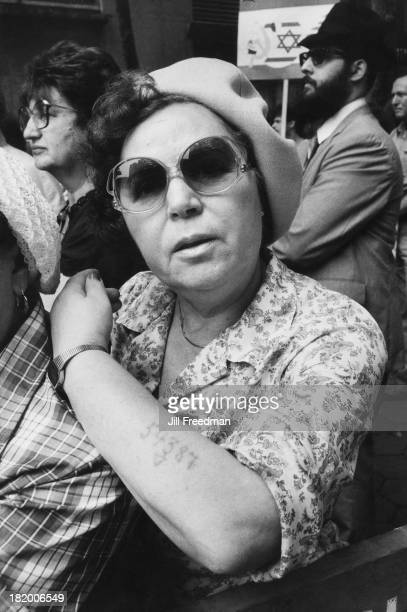 A Holocaust survivor shows her concentration camp identity tattoo at the 'Salute To Israel' march New York City 24th May 1982