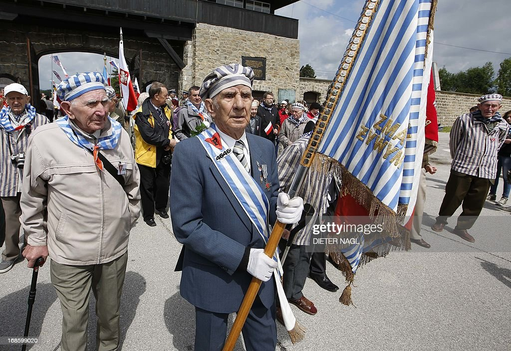 Holocaust survivors arrive with the Polish delegation during a commemoration of the liberation of the Nazi concentration camp Mauthausen on May 12, 2013, 160 kilometers near Vienna. AFP PHOTO / DIETER NAGL