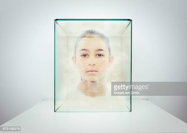 Hologram of Mixed race girl in glass box