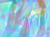 Holographic iridescent surface wrinkled foil pastel. Vivid Hologram Background of wrinkled abstract foil texture with multiple colors. gradient mesh surface.