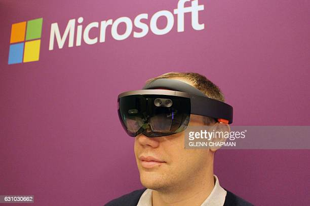 HoloLens director of communications Craig Cincotta wears the Microsoft altered reality headgear in a demonstration room at the Consumer Electronics...