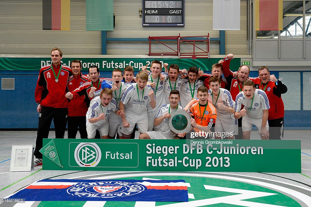 Holstein Kiel players celebrate after winning the DFB C Juniors Futsal Cup on March 24 2013 in Bergkamen Germany