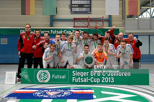 Holstein Kiel players celebrate after winning the DFB C Juniors Futsal Cup on March 24 2013 in Bergkamen Germany