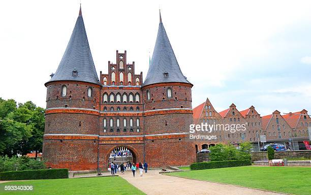 Holstentor Gate, Lubeck, Germany. Tourists walking