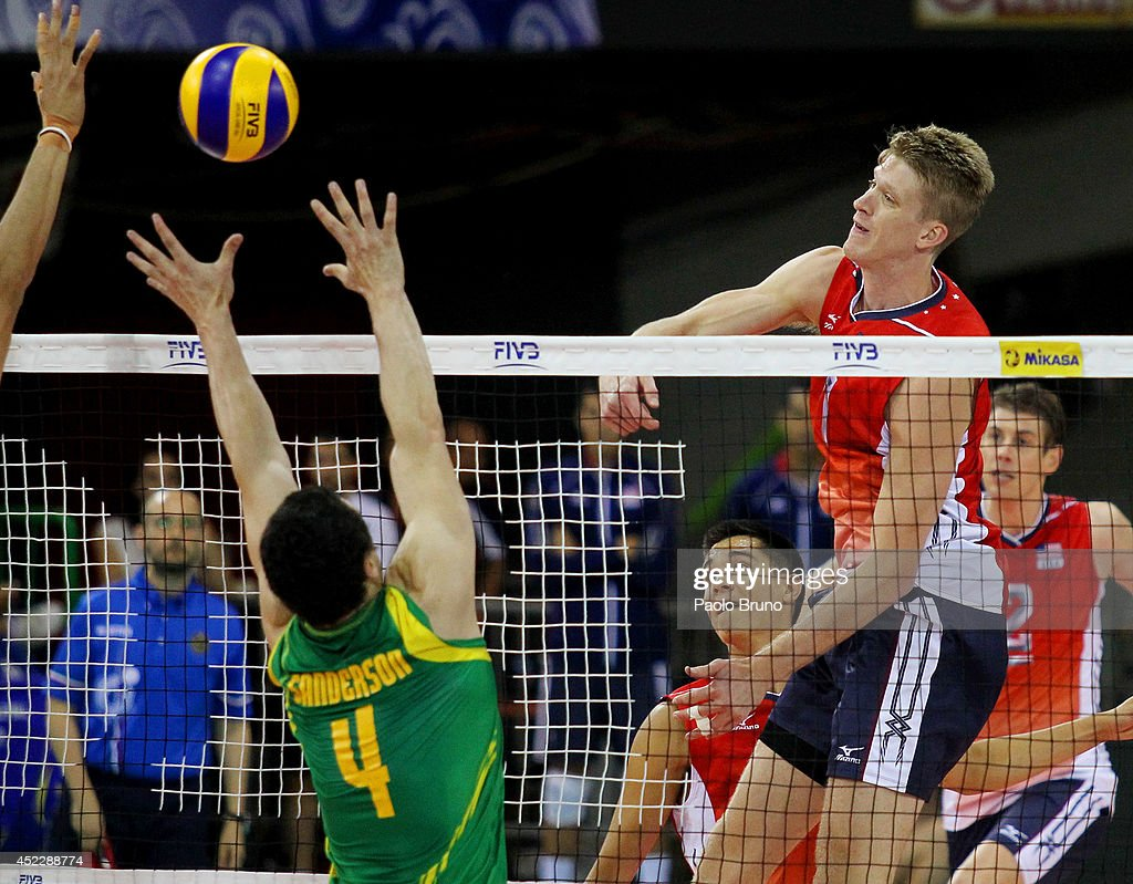 Holt Maxwell of United States spikes the ball as Paul Sanderson of Australia block during the FIVB World League Final Six match between United States and Australia at Mandela Forum on July 17, 2014 in Florence, Italy.