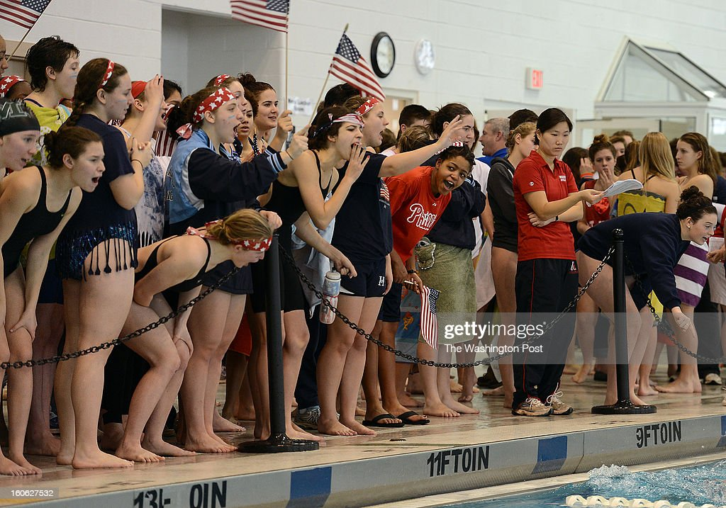 Holton-Arms swim team members cheer on a swimmer from their team during the Washington Metropolitan Prep School Swim Dive League Championships at the Takoma Aquatic Center on Saturday, February 2, 2013. The team chose the theme 'One Nation Under Water' for the meet.