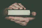 Hand with Holy Bible book. Freedom of religion concept.