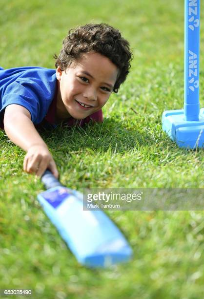 Holy Cross Student Matai Baker Recipient of the ANZ Dream Big presentation slides into the pitch while playing a game of cricket as part of an ANZ...