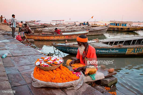 Holy man with flower garlands at Ganges ghat