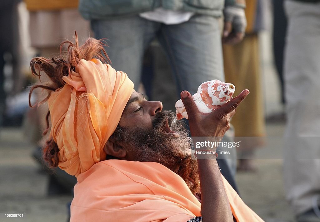 Holy men after takes dip at banks of the Sangam ahead of Maha Kumbh festival on January 13, 2013 in Allahabad, India. The Kumbh Mela is mass Hindu pilgrimage that alternates between four places Allahabad, Haridwar, Ujjain and Nashik every three years. The current Kumbh Mela is scheduled to take place at Allahabad city in January and February 2013 and is expected to be attended by 60 million devotees.