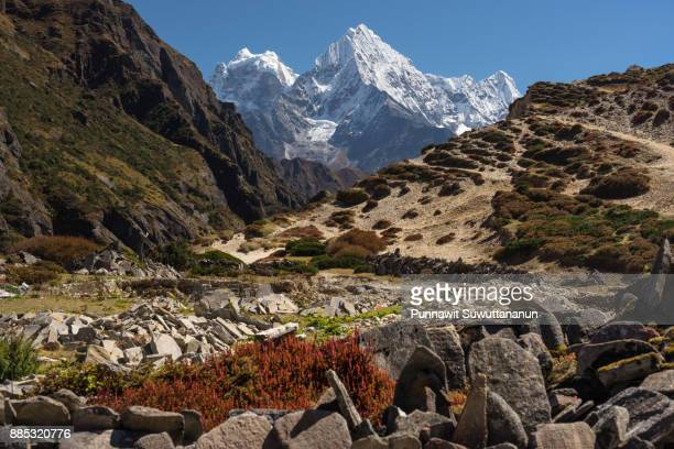 Holy stone in front of Thamserku mountain peak, Everest region, Nepal