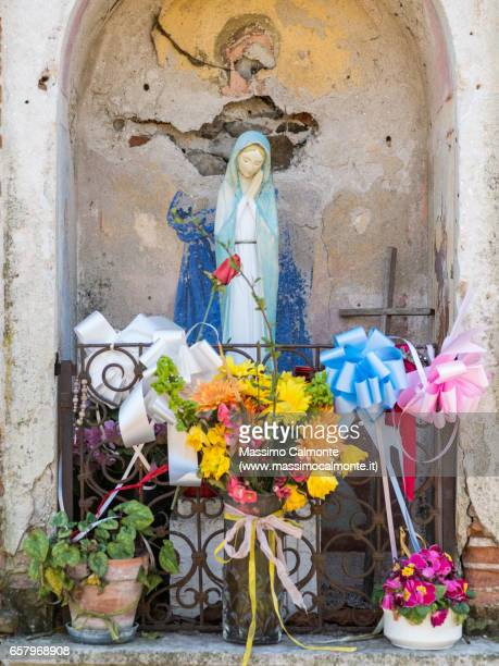 Holy Vergine Maria statue on the road