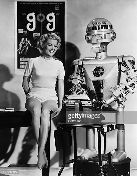Lovely Sally Mansfield is on hand to held 'Garco' Hollywood's first mechanical press agent as he bats out a hot press release about a new...