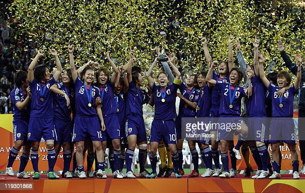 Homara Sawa of Japan lifts the trophy after winning the FIFA Women's World Cup Final match between Japan and USA at the FIFA World Cup stadium...