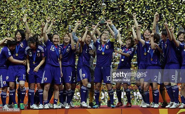 Homara Sawa of Japan lifts the trophy after winning the FIFA Women's World Cup Final match between Japan and USA at the FIFA World Cup stadium...