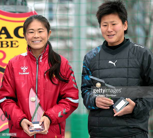 Homare Sawa and Ayumi Kaihori pose with the trophy after awarded the Kobe City Sports Special Contribution Prize during the INAC Kobe Leonessa Fan...