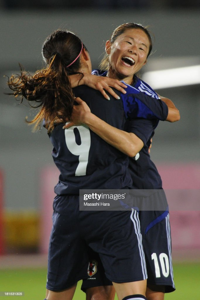 Homare Sawa #10 and Nahomi Kawasumi #9 of Japan celebrate the second goal during the Women's international friendly match between Japan and Nigeria at Nagasaki Stadium on September 22, 2013 in Isahaya, Nagasaki, Japan.
