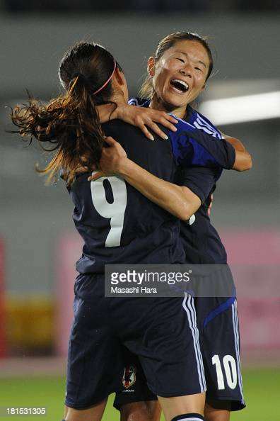 Homare Sawa and Nahomi Kawasumi of Japan celebrate the second goal during the Women's international friendly match between Japan and Nigeria at...