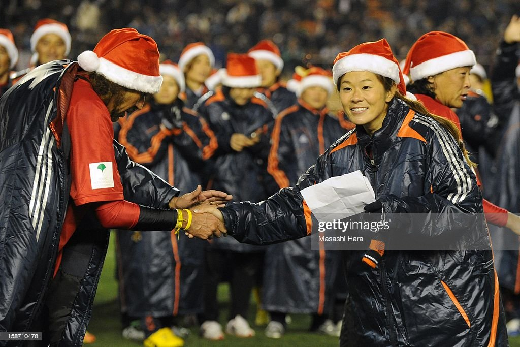 Homare Sawa (R) and Rui Ramos shake hands after the Great East Japan Earthquake charity match 'SAWA and Friends, X'mas Night 2012' at the National Stadium on December 25, 2012 in Tokyo, Japan.