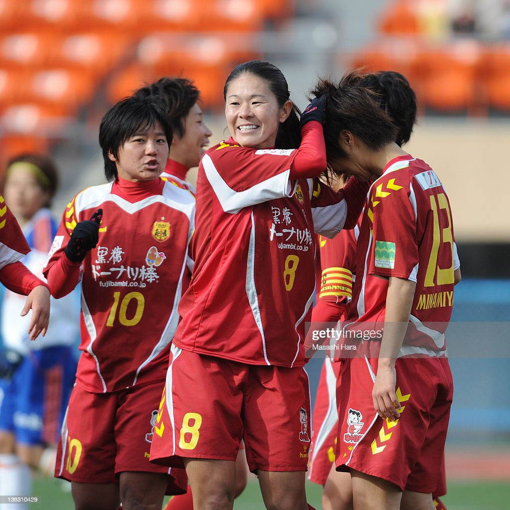 Homare Sawa #8 (C),celebrates with team mates Shinobu Ohno #10 (L) and Chiaki Minamiyama #13 (R) after their second goal during the All Japan Women's Soccer Championship Final match between Albirex Niigata Ladies and INAC Kobe Leonessa at the National Stadium on January 1, 2012 in Tokyo, Japan.