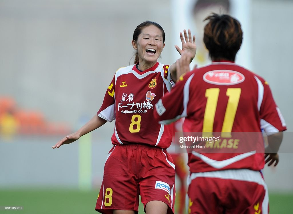 Homare Sawa #8 of INAC Kobe Leonessa celebrates Megumi Takase's goal during the Nadeshiko League match between AS Elfen Sayama and INAC Kobe Leonessa at NACK 5 Stadium Omiya on September 30, 2012 in Saitama, Japan.