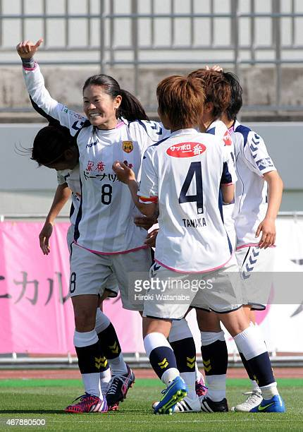 Homare Sawa of INAC Kobe Leonessa celebrates scoring her team's third and winning goal with her team matesduring the Nadeshiko League match between...