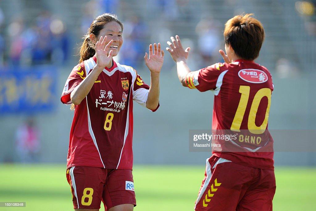 Homare Sawa #8 of INAC Kobe Leonessa (L) celebrates Shinobu Ohno's goal during the Nadeshiko League match between AS Elfen Sayama and INAC Kobe Leonessa at NACK 5 Stadium Omiya on September 30, 2012 in Saitama, Japan.