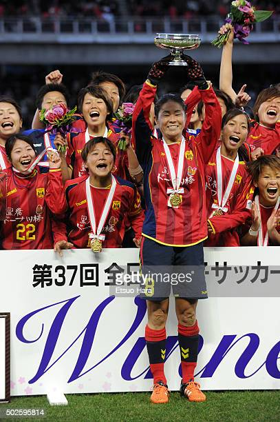Homare Sawa of INAC Kobe Leonessa celebrates with the trophy during the 37th Empress's Cup All Japan Women's Championship final match between INAC...