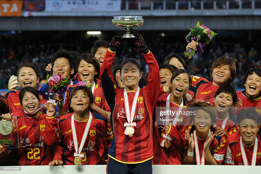 Homare Sawa of INAC Kobe Leonessa holds the cup after the 37th Empress's Cup All Japan Women's Championship final match between INAC Kobe Leonessa and Albirex Niigata Ladies at the Todoroki Stadium on December 27, 2015 in Kawasaki, Kanagawa, Japan.