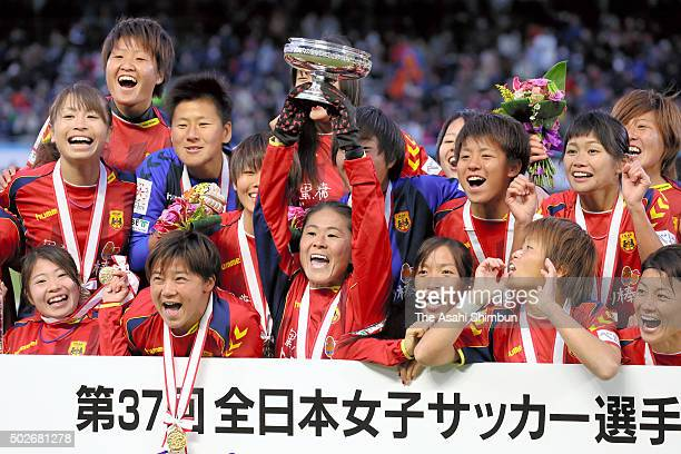 Homare Sawa of INAC Kobe Leonessa lifts the trophy after winning the 37th Empress's Cup All Japan Women's Championship final match between INAC Kobe...