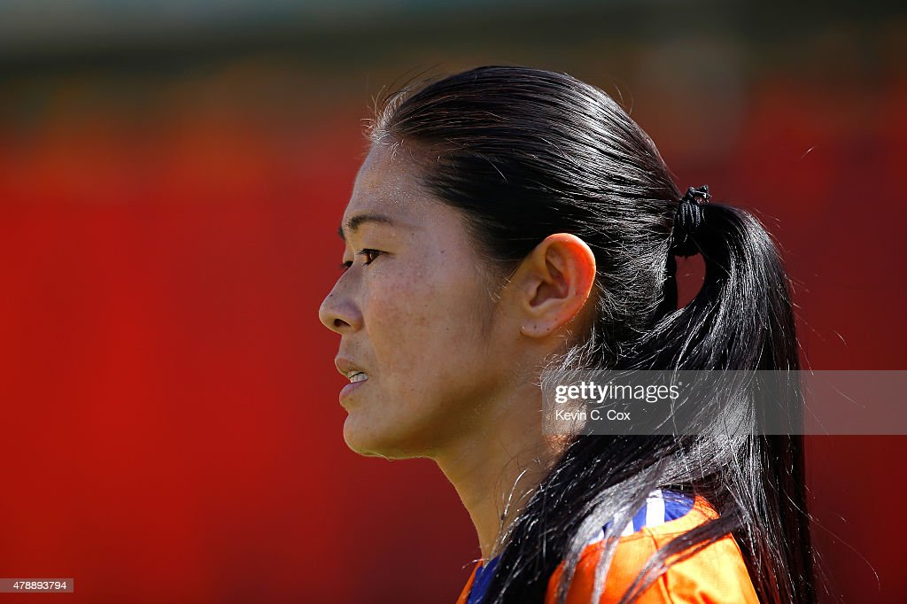 <a gi-track='captionPersonalityLinkClicked' href=/galleries/search?phrase=Homare+Sawa&family=editorial&specificpeople=744563 ng-click='$event.stopPropagation()'>Homare Sawa</a> #10 of Japan against Australia during the FIFA Women's World Cup Canada 2015 Quarter Final match between Australia and Japan at Commonwealth Stadium on June 27, 2015 in Edmonton, Canada.