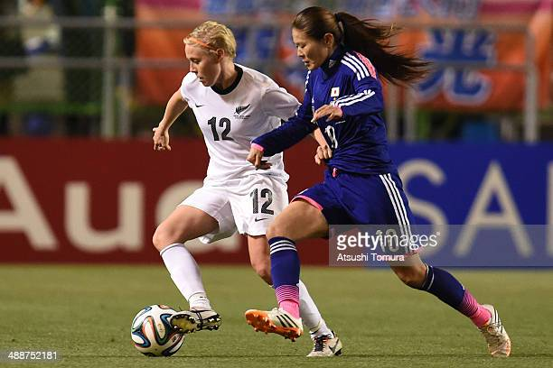 Homare Sawa of Japan and Betsy Hassett of New Zealand in action during the women's international friendly match between Japan and New Zealand at...