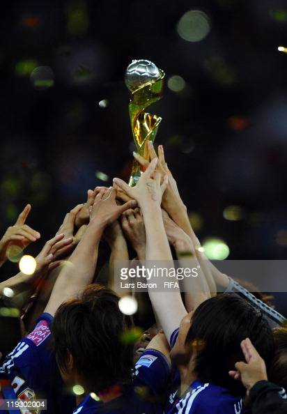 Homare Sawa of Japan and her team mates lift the trophy after winning the FIFA Women's World Cup Final match between Japan and USA at the FIFA...