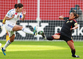 Homare Sawa of Japan and Maribel Dominguez of Mexico battle for the ball during the FIFA Women's World Cup 2011 Group B match between Japan and...