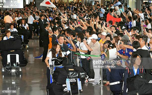 Homare Sawa of Japan and other players are welcomed by fans on arrival at Narita International Airport on July 19 2011 in Narita Chiba Japan